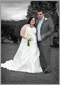 Pregnant bride with her groom in the garden with a B & W background