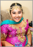 Asian groom's younger sister posing whilst awaiting transport