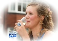 Prom night girl taking a sip of Champagne
