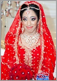 An Asian bride in her red dress