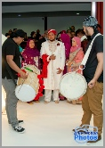 Asian groom arrives at the venue accompanied by a pair of drummers