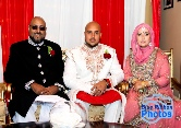 Groom poses with his mum & dad prior to his Asian wedding