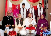 Some of the groom's family pose as a group prior to the Asian wedding ceremony