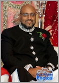 Grooms father poses prior to the Asian wedding of his son